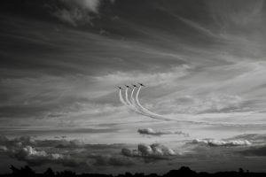 Four airborne airplanes flying in unison